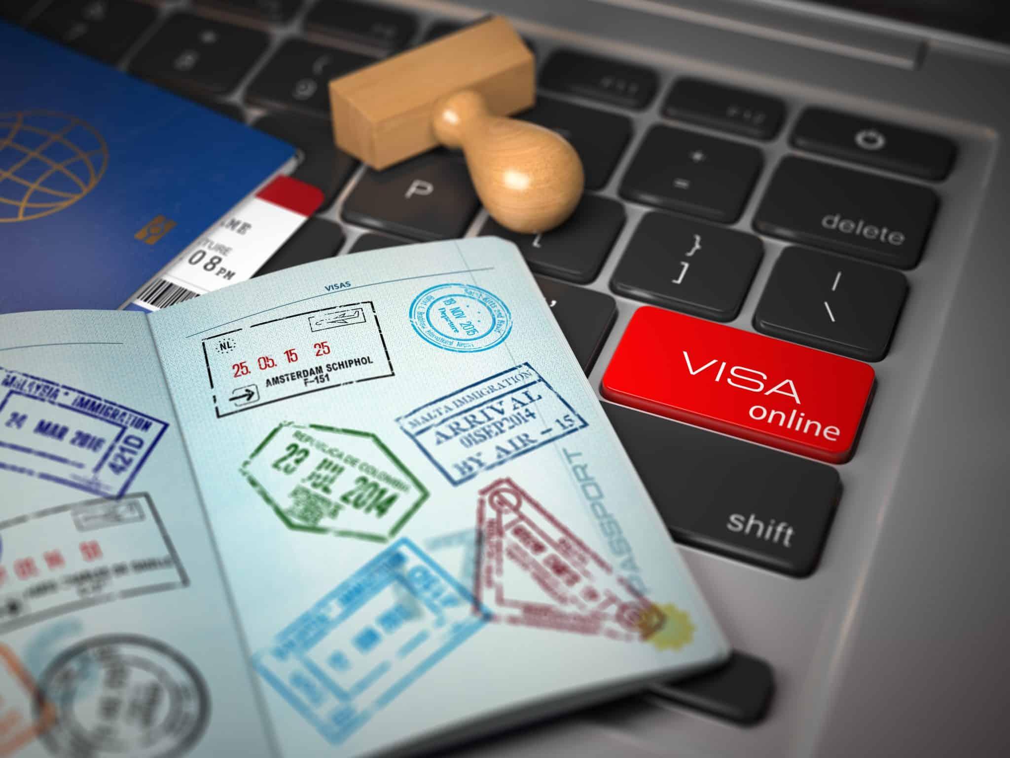 Visa online application concept. Open passport with visa stamps image